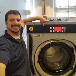 Man Standing Beside A Washer